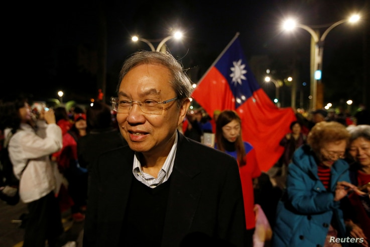 Hong Kong academic and activist Joseph Cheng observes a Kuomintang (KMT) rally ahead of the election in Taipei, Taiwan January…