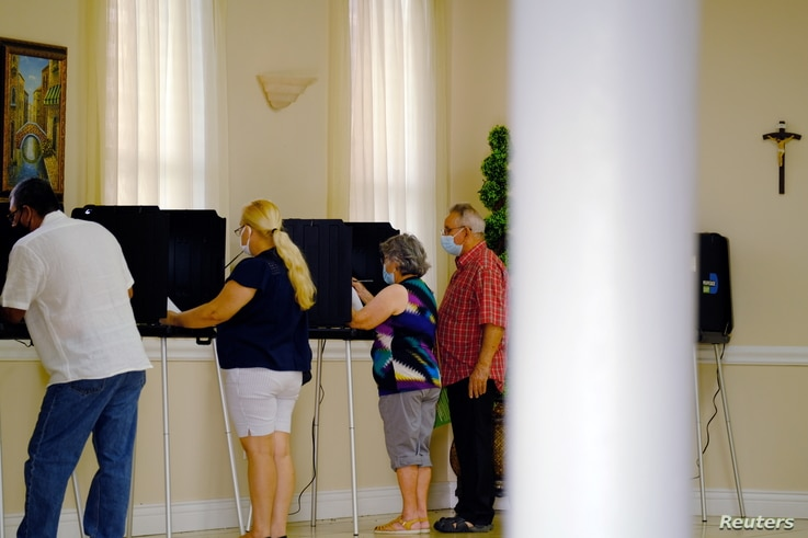 Voting in Miami, Florida, Nov. 3, 2020. A majority of white women have voted for the Republican candidate since 2000, and that was the case in 2020.