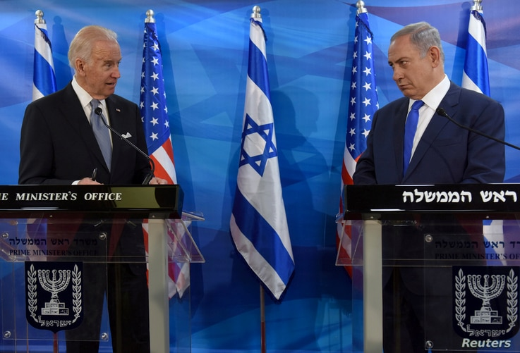 FILE PHOTO: U.S. Vice President Joe Biden (L) and Israeli Prime Minister Benjamin Netanyahu look at each other as they deliver…