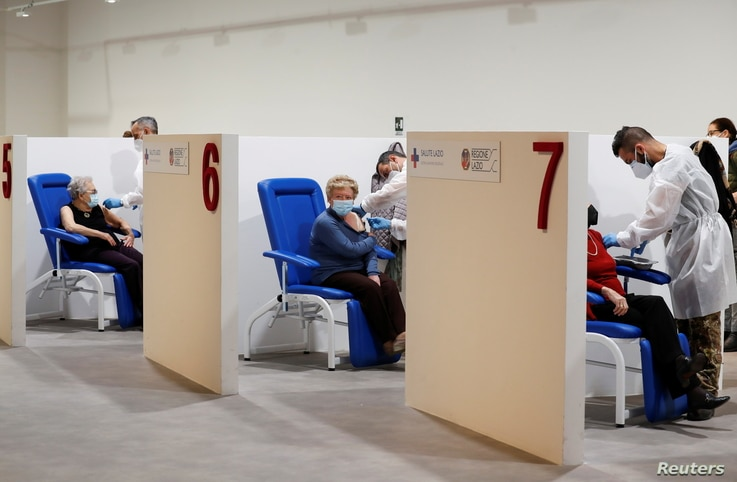 Women receive the Moderna vaccine against the coronavirus disease (COVID-19) at the Music Auditorium in Rome, Italy, April 14,…