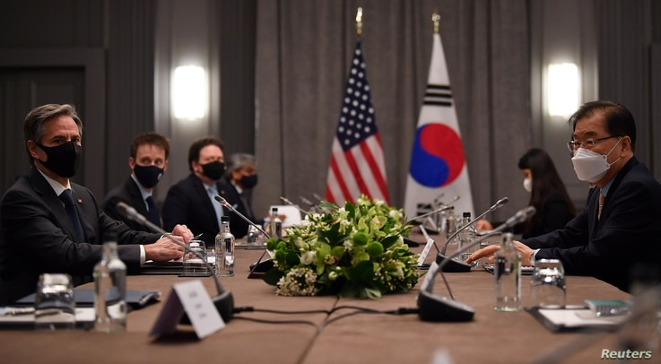 U.S. Secretary of State Antony Blinken speaks with South Korea's Foreign Minister Chung Eui-yong during a bilateral meeting.