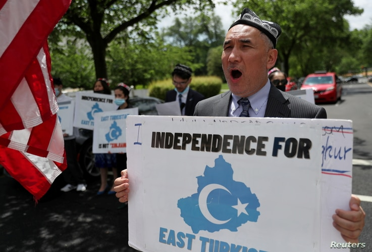 Demonstrators, including Aziz Sulayman, hold a protest in front of the U.S. State Department to commemorate Uyghur Doppa Day...