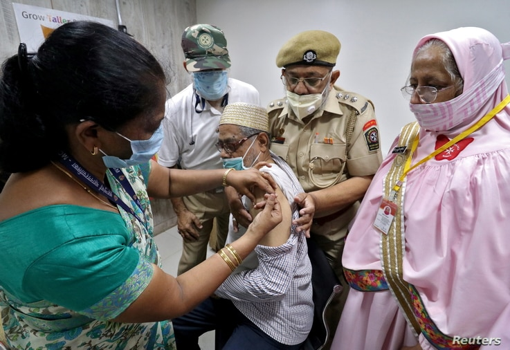 A man receives a dose of COVISHIELD, a coronavirus disease (COVID-19) vaccine manufactured by Serum Institute of India, at a…