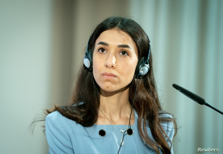 Nobel Peace Prize laureate and Yazidi activist Nadia Murad meets German FM Heiko Maas during a symbolical start of the lectures...