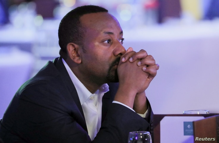 Ethiopia's Prime Minister Abiy Ahmed attends the launch of a mobile phone-based financial service named Telebirr mobile money…