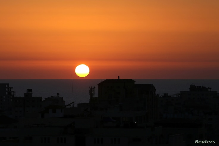 The sun sets over the Mediterranean Sea off the coast of Gaza City as cross-border violence between the Israeli military and…