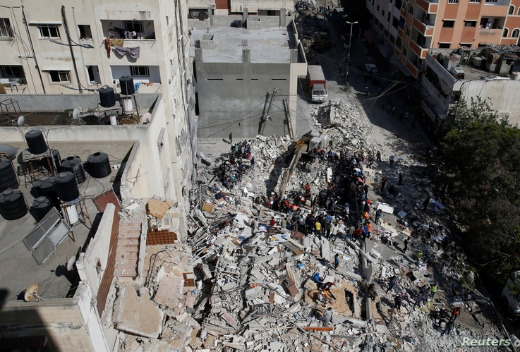 A general view as rescue workers search for victims amid rubble at the site of Israeli airstrikes, in Gaza City May 16, 2021.