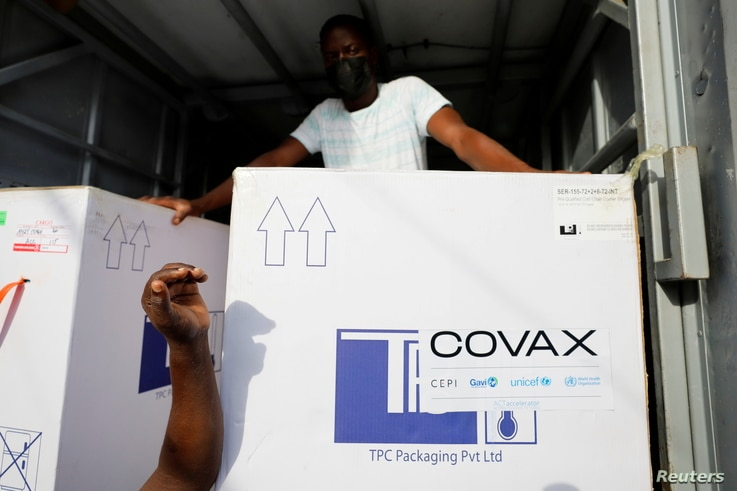FILE PHOTO: Boxes of AstraZeneca/Oxford coronavirus vaccines, redeployed from the Democratic Republic of Congo, arrive at a...