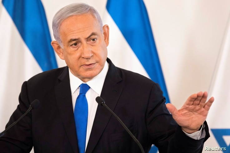 Israeli Prime Minister Benjamin Netanyahu gestures as he speaks during a briefing to ambassadors to Israel at a military base…