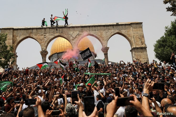 Palestinians react at the compound that houses Al-Aqsa Mosque, known to Muslims as Noble Sanctuary and to Jews as Temple Mount.