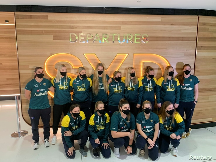 Members of Australia's Olympic softball squad at Sydney Airport on May 31, 2021 before their departure for a pre-Games training…