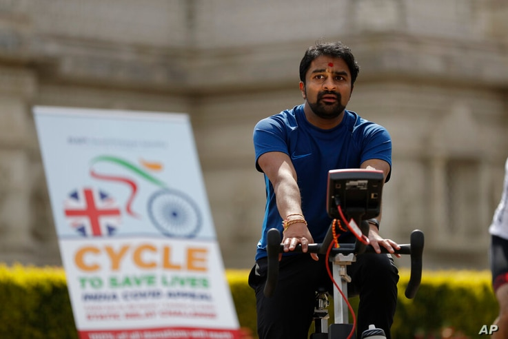 A man takes part in 'Cycle to Save Lives' a 48 hour, non-stop static relay cycle challenge at the BAPS Shri Swaminarayan Mandir...