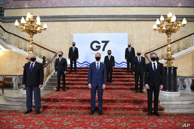 G7 foreign ministers wear face masks and are socially distanced for a group photo on the stairs at Lancaster House in London ahead of talks at the G7 foreign and development ministers meeting in London, May 4, 2021.