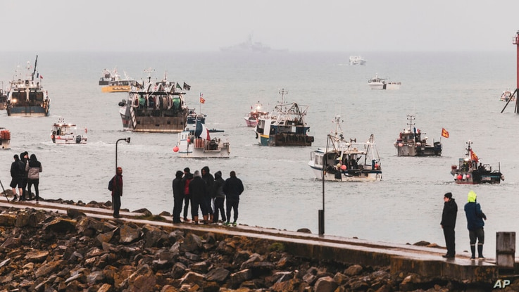 Fishing vessels at sea off the coast of Jersey, Thursday, May 6, 2021. French fishermen angry over loss of access to waters off…