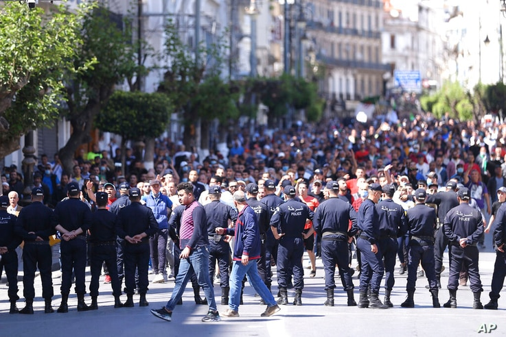 Demonstrators march in Algiers, Friday, May 7, 2021 in support for the Hirak pro-democracy movement. (AP Photo/Anis Belghoul)