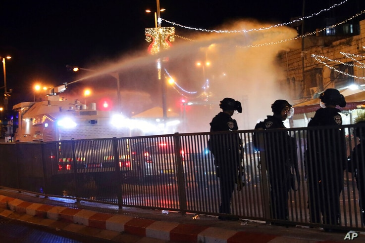 Israeli police use a water cannon to disperse Palestinian protesters from the area near the Damascus Gate to the Old City of...