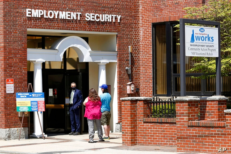 Job seekers line up outside the New Hampshire Works employment security job center, Monday, May 10, 2021, in Manchester, N.H…