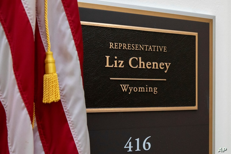 A sign bearing the name of Rep. Liz Cheney, R-Wyo., outside of her office on Capitol Hill in Washington.