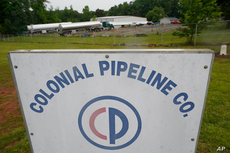 Tanker trucks are parked near the entrance of Colonial Pipeline Company Wednesday, May 12, 2021, in Charlotte, N.C. Several...