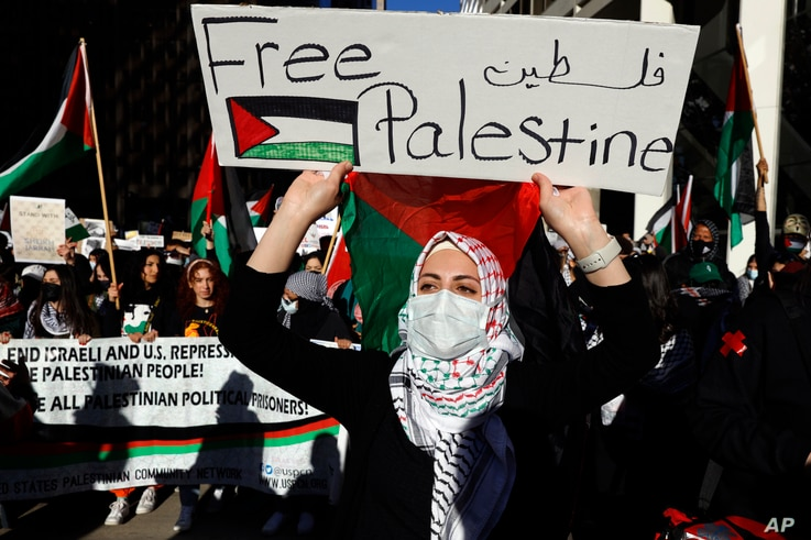 Protesters march through the streets of Chicago's Loop in support of Palestinians, May 12, 2021.