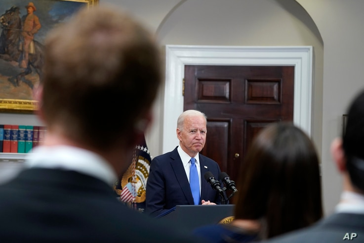 President Joe Biden responds to questions from the media after delivering remarks about the Colonial Pipeline hack, in the...