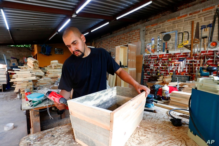Jesus Lopez works in his family's carpentry workshop in Zapopan, Jalisco state, Mexico, May 13, 2021.