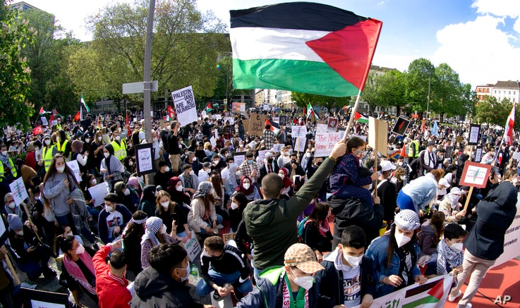 People attend a protest rally in solidarity with Palestinians in Berlin, Germany, Saturday, May 15, 2021. (AP Photo/Michael…