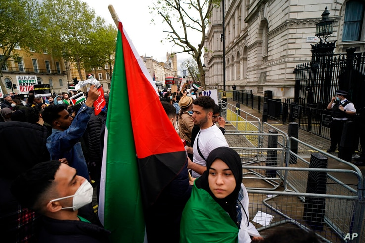 People gather outside Downing Street to protest against Israeli attacks on Palestinians in Gaza, in London, Saturday, May 15,…