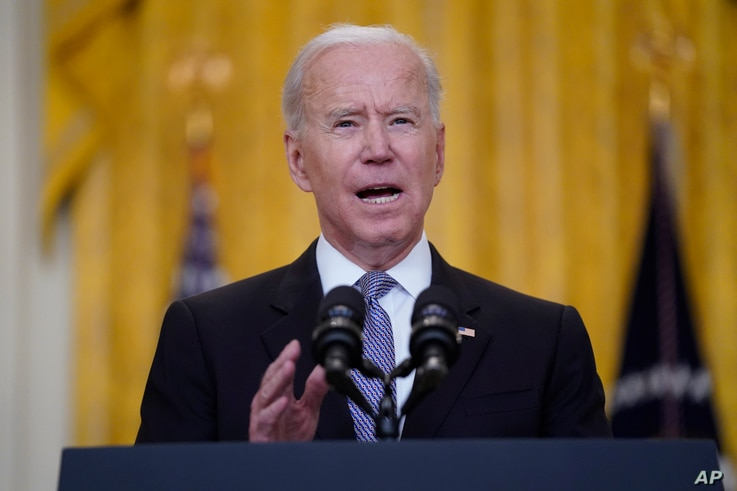 President Joe Biden speaks about distribution of COVID-19 vaccines, in the East Room of the White House, Monday, May 17, 2021,…