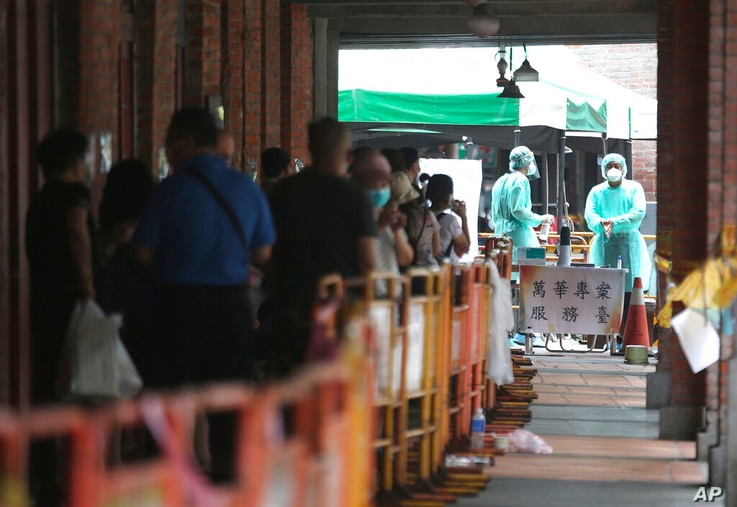 People line up at a rapid coronavirus testing center after the COVID-19 alert raise to level 3 in Taipei, Taiwan, Tuesday, May…