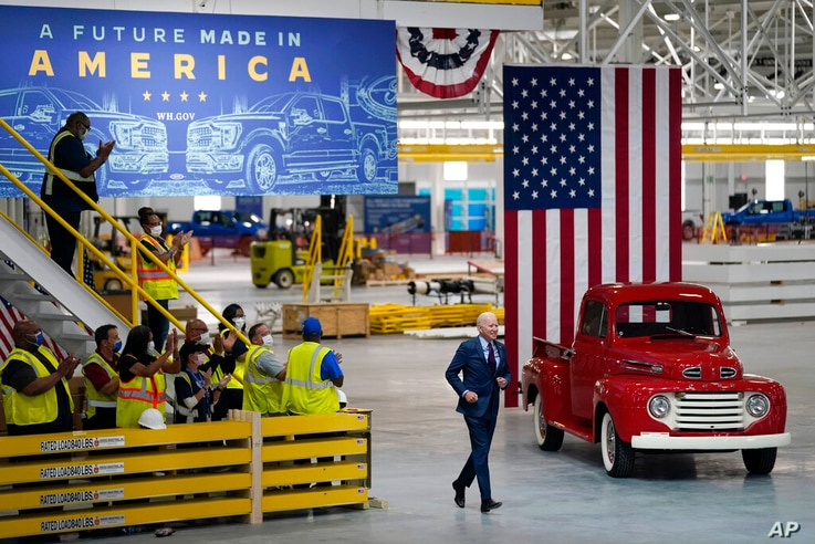 President Joe Biden arrives to speak after a tour of the Ford Rouge EV Center, Tuesday, May 18, 2021, in Dearborn, Mich. (AP…