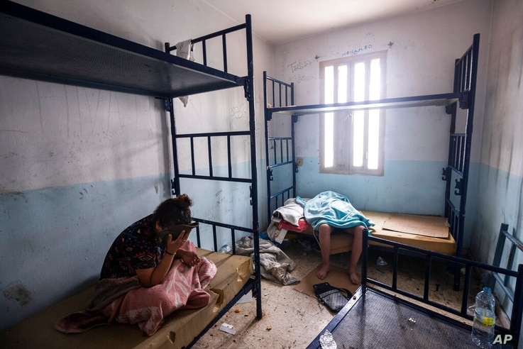 Minors who crossed into Spain take shelter inside an abandoned building in Ceuta, Friday, May 21, 2021. Spain says it has…