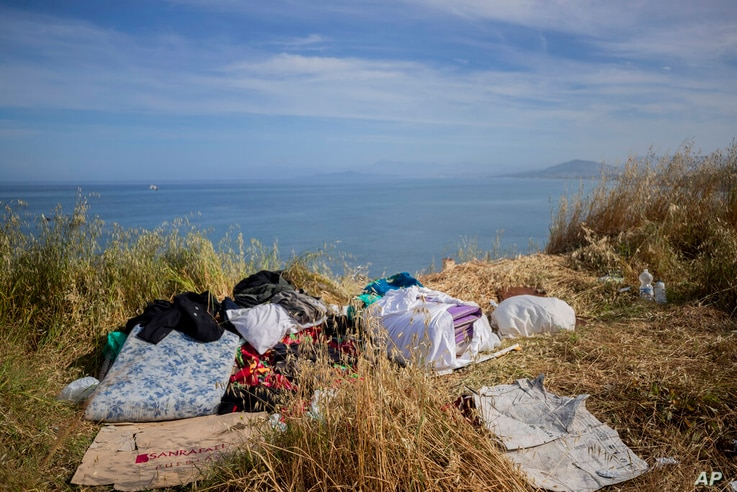 Mattress and belongings of migrants sit atop of a hill in the Spanish enclave of Ceuta, near the border of Morocco and Spain,…