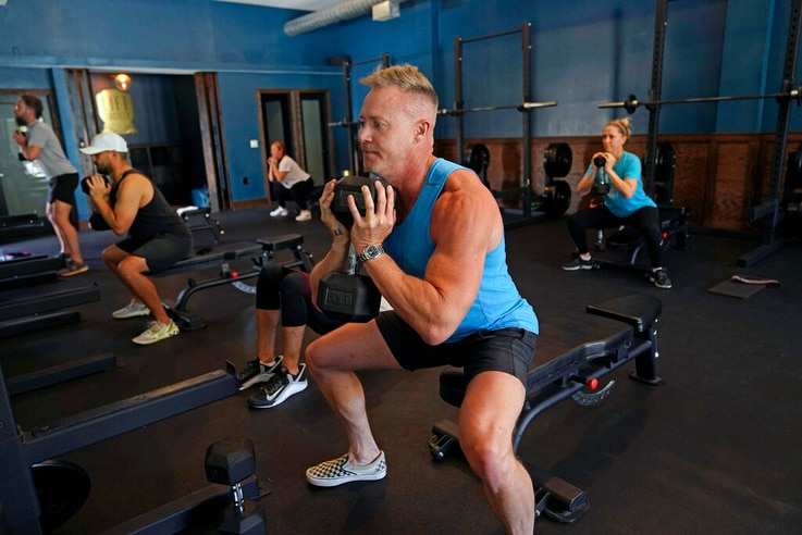 Scott Johnson, foreground in blue, participates in a fitness class at Lift Society Friday, May 21, 2021, in Studio City, Calif…