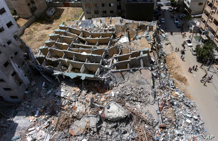 An aerial view of the destroyed building housing the offices of The Associated Press and other media, after it was hit last…