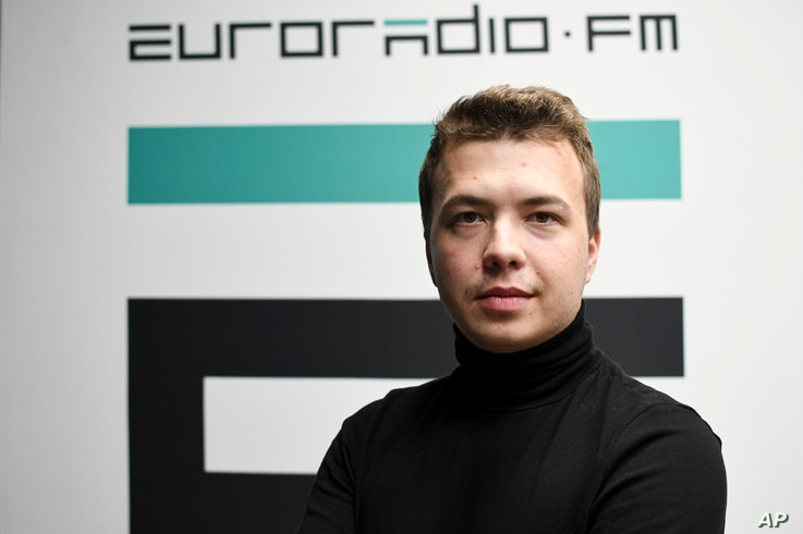 In this handout photo released by European Radio for Belarus, Belarus journalist Raman Pratasevich poses for a photo.