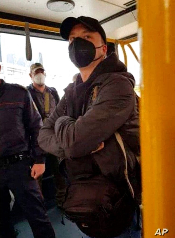 In this photo released by telegram Chanel t.me/motolkohelp, Belarus journalist Raman Pratasevich wearing a face mask to protect…