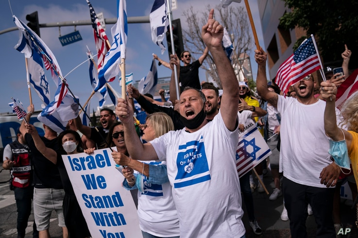 FILE - Pro-Israel supporters chant slogans during a rally in support of Israel outside the Federal Building in Los Angeles,…