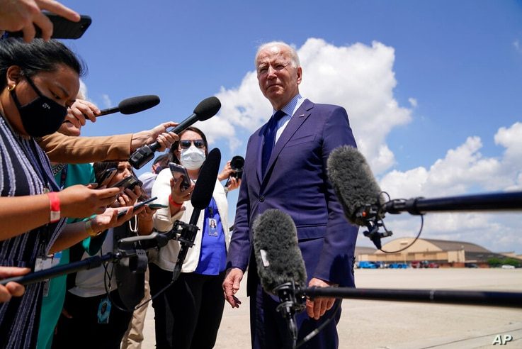 President Joe Biden speaks to members of the media before boarding Air Force One for a trip to Cleveland, Thursday, May 27,…