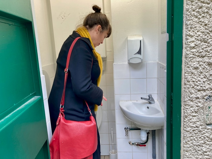 Briand checks out a restroom in a small square and pronounces it