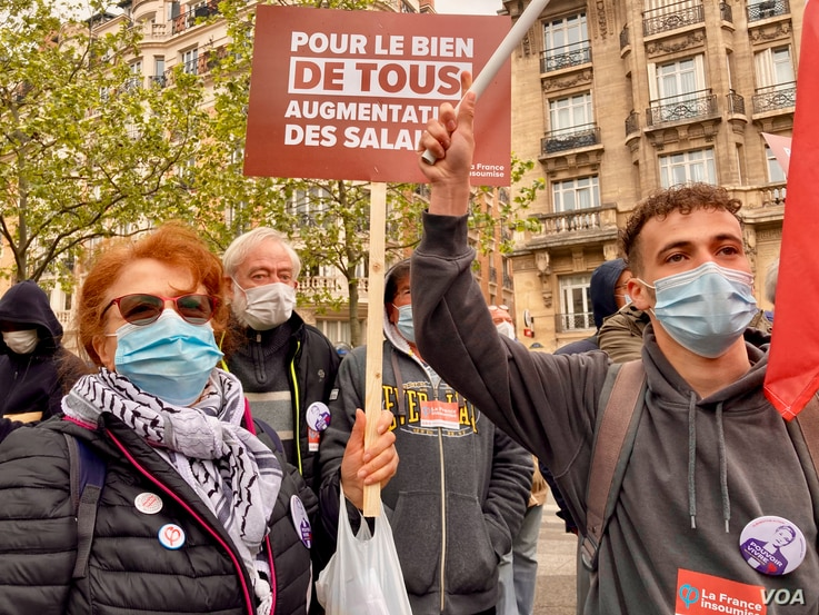 Protester Frikia, left, offered a raft of complaints against the government, during the International Workers' Day march in Paris, May 1, 2021. (Lisa Bryant/VOA)