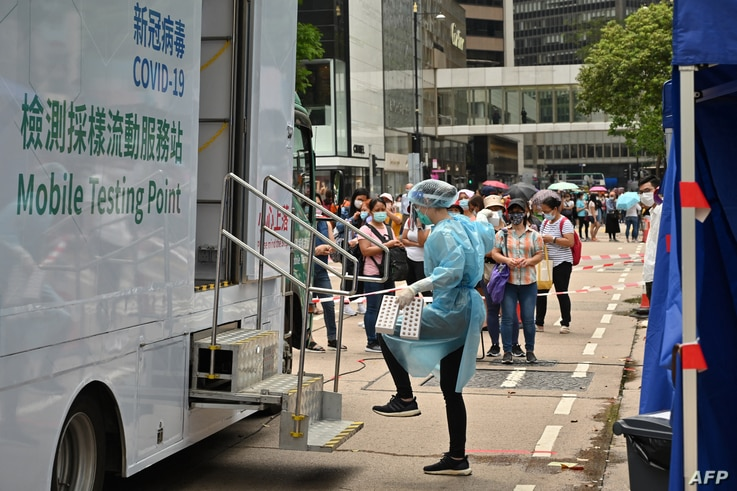 Migrant workers queue up for Covid-19 testing in the Central district of Hong Kong, May 1, 2021.