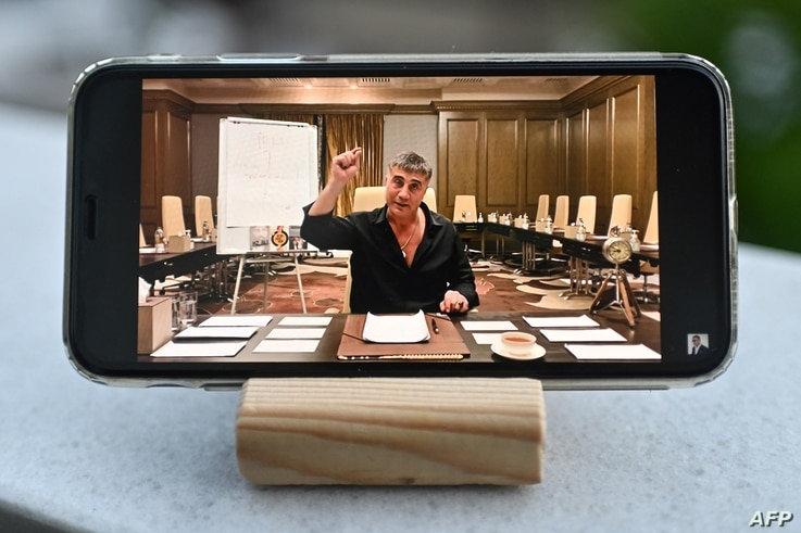 FILE - A photo taken May 26, 2021, in Istanbul, Turkey, shows a YouTube broadcast by exiled mob boss Sedat Peker on a mobile phone.