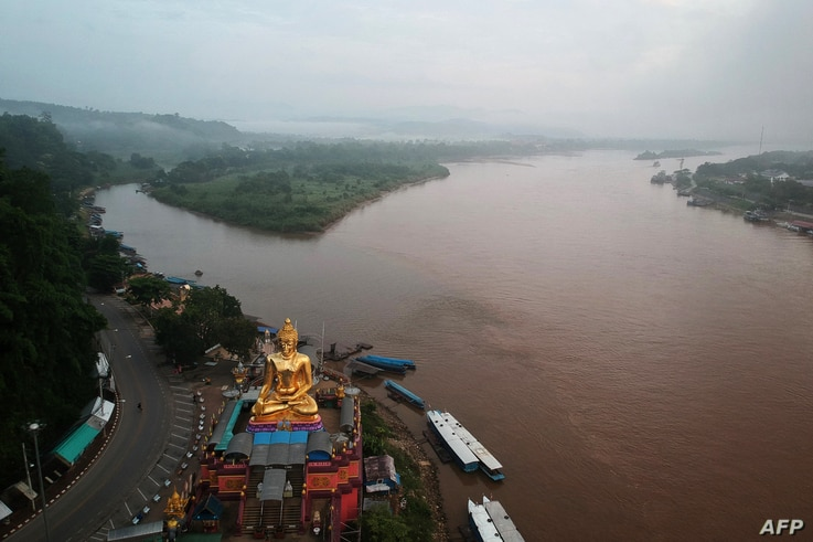 FILE - A giant Buddha on the Thai side of the Golden Triangle in Chiang Rai province, is seen with Myanmar in the background and Laos on the right, Sept. 20, 2019.