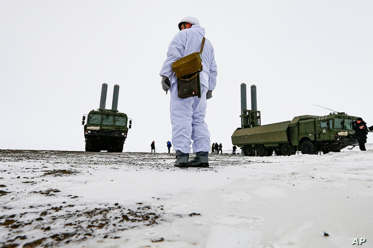 FILE - An officer stands near Bastion anti-ship missile systems on the Alexandra Land island near Nagurskoye, Russia, May 17, 2021.