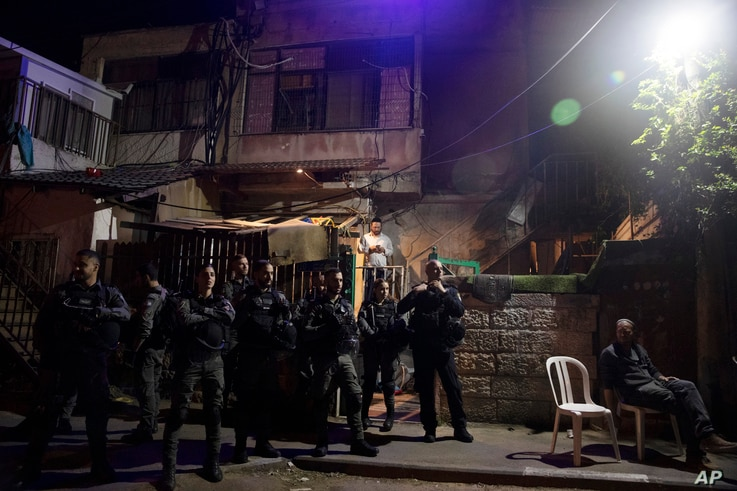 Israeli police stand guard in front of a Palestinian home occupied by settlers during a protest ahead of a court verdict that may forcibly evict Palestinian families from their homes, in the Sheikh Jarrah neighborhood of Jerusalem, May 5, 2021.
