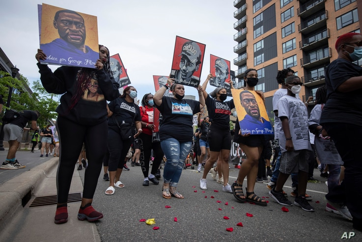 Family members of Daunte Wright march for the one-year anniversary of George Floyd's death, in Minneapolis, Minnesota, May 23, 2021.