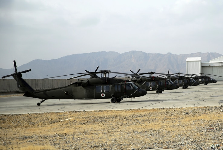 FILE - Blackhawk helicopters are seen lined up at Kandahar Airfield, Afghanistan, Jan. 23, 2018.