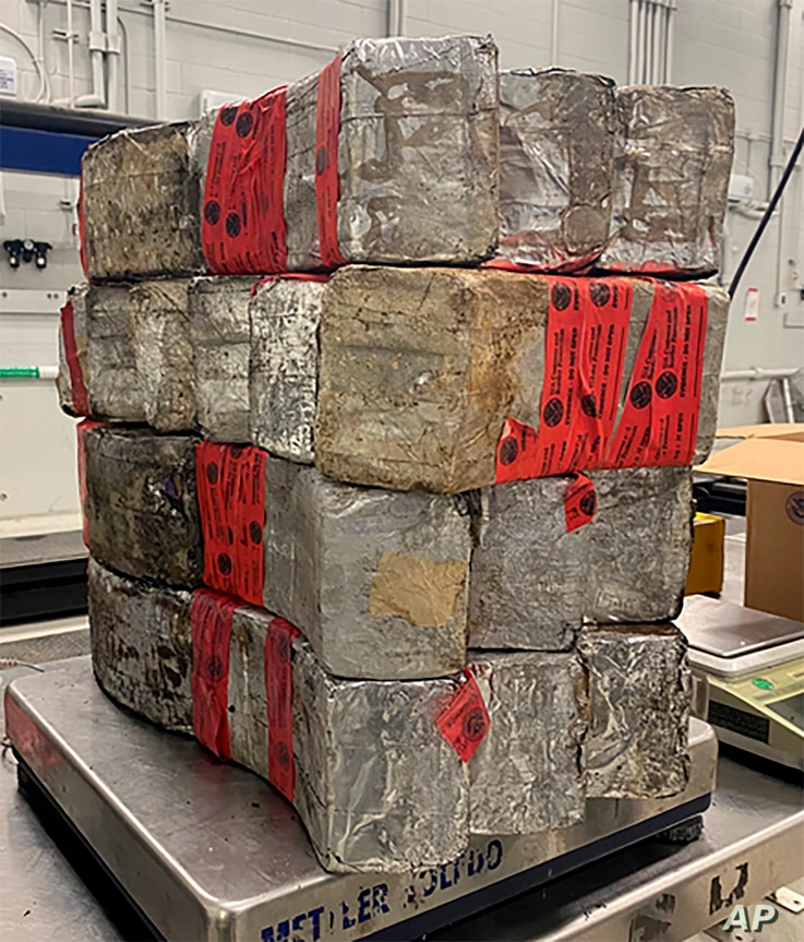 This undated photo provided by the U.S. Customs and Border Protection shows seized drug bundles containing 132 pounds of methamphetamine on display from Feb. 25, 2021, at the Laredo port of entry.