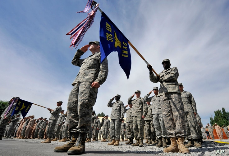 FILE - U.S. soldiers take part in a change-of-command ceremony at the Manas airbase that has supported U.S. military operations in Afghanistan, outside Bishkek, Kyrgyzstan, June 14, 2011. (AP)